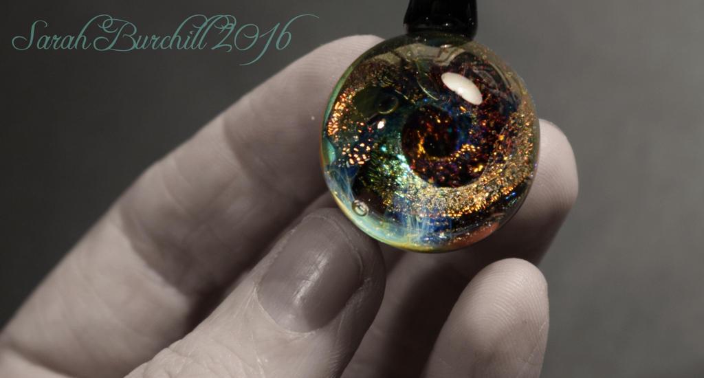 Galaxy pendant ''Carousel'' by fairyfrog