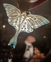 Luna Moth pendant in transluscent horn by WeirdWondrous