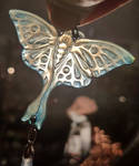 Luna Moth pendant in transluscent horn