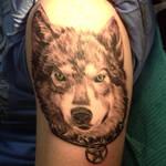 Black and grey wolf tattoo