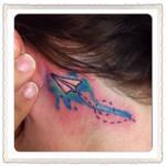 Watercolor paper plane tattoo