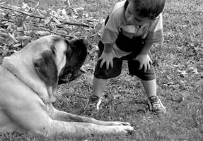 A Boy and a Puppy by brindlegreyhound