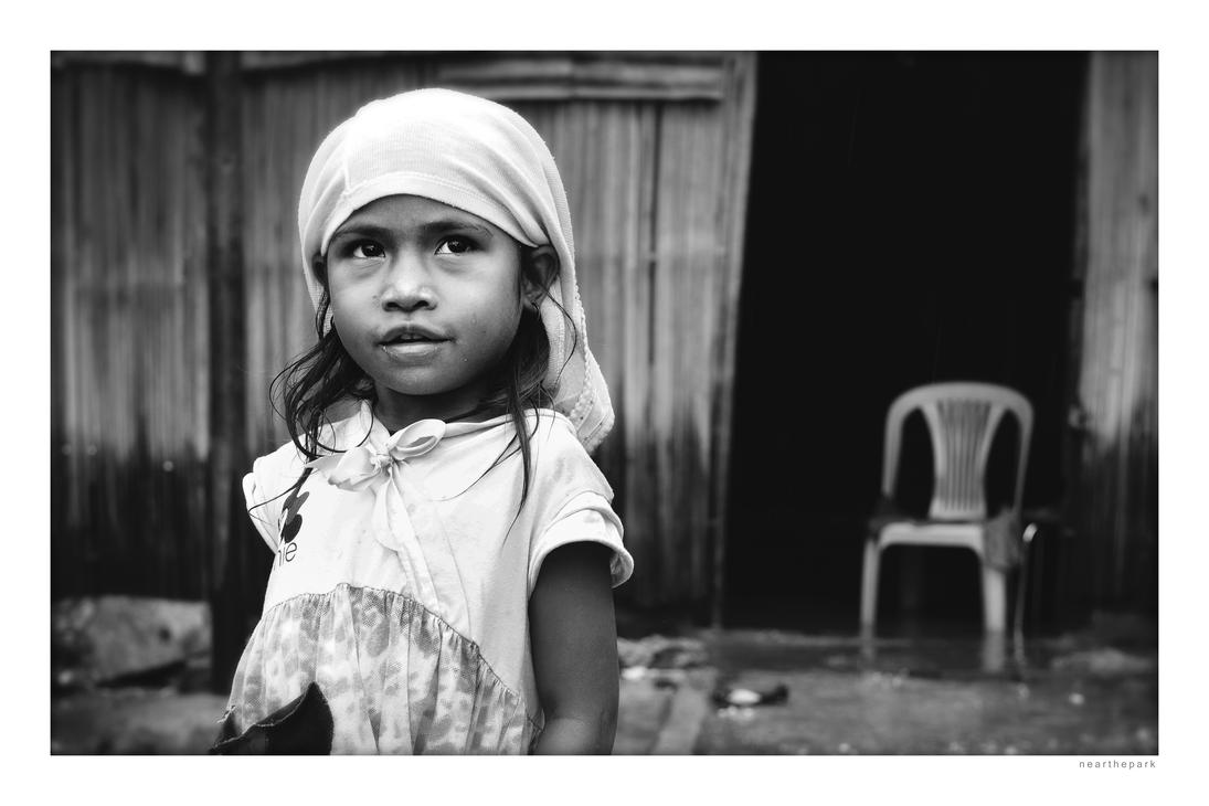 Little girl outside house. Dili, Timor-Leste by nearthepark