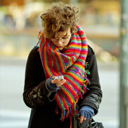 Girl in rainbow scarf by attomanen