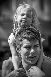 Tired girl on her fathers shoulders by attomanen