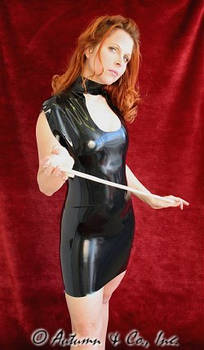 Domme Autumn in a latex dress