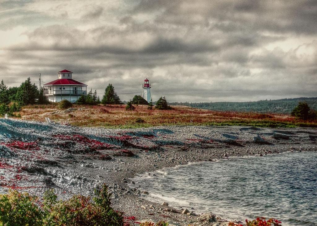 Lighthouse Point in Gabarus Cape Breton island by ShawnaMac