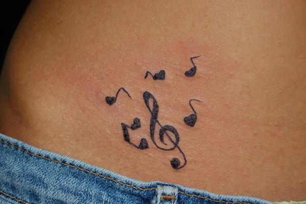 Her First Tattoo.. 'Clef'