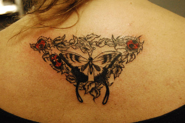 Tribal Tattoo Tramp Stamp. tramp stamp butterfly vines