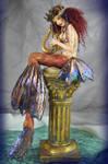 Mermaid playing harp sculpture