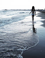 walking on the beach by Hyenn