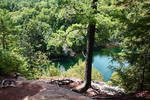 Cliff over pond