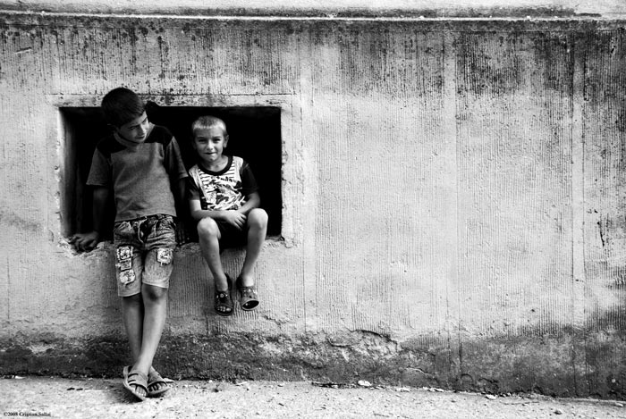 children in a square by csallai