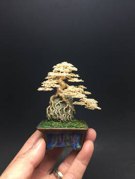 Root-over-rock wire bonsai tree by Ken To