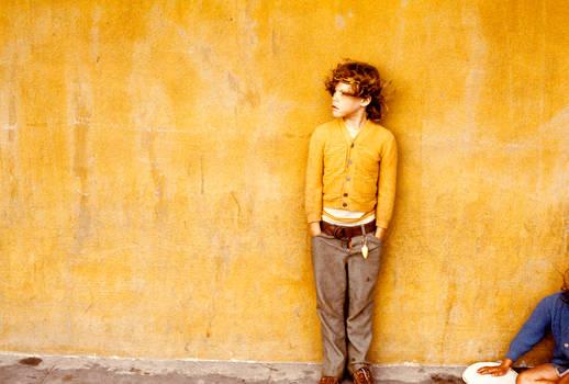 Boy in gold sweater