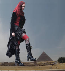 Goddess Amarie crushes another God under her boots