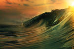 Ocean breaking surfing wave at sunset time