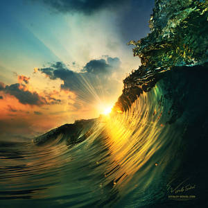 Sunset on the beach with surfing ocean wave