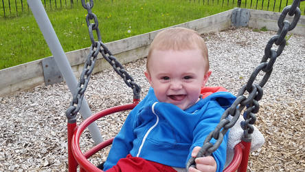 nephew first time on the swing