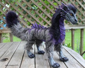 Purple creature doll