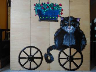 Cat on a wheel