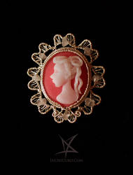 Salmon cameo brooch