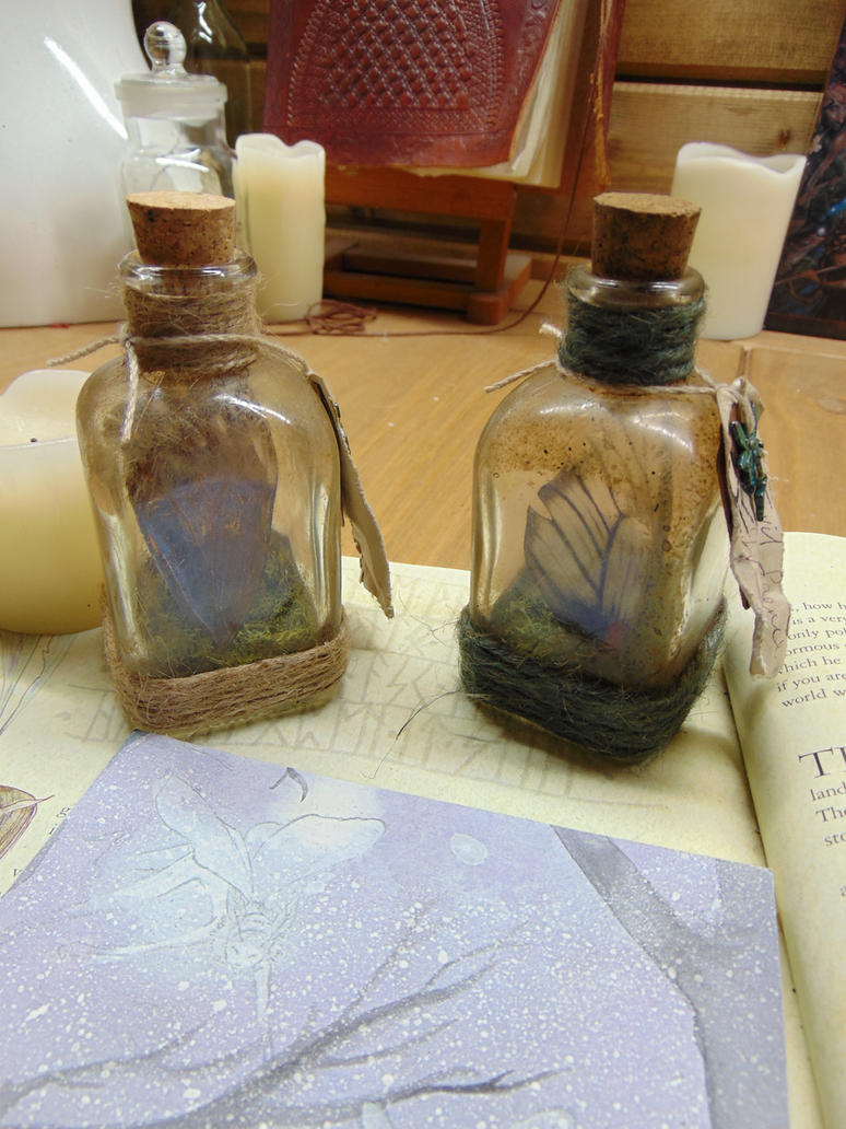 Good and Evil Faerie Wing Specimen Jars by BurnedRavenTales