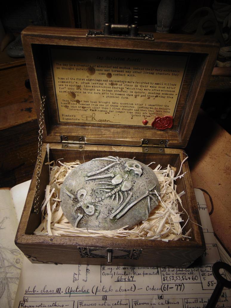 Imp Skeleton Fossil by BurnedRavenTales