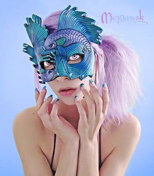 Beki wearing Fighting Fish mask