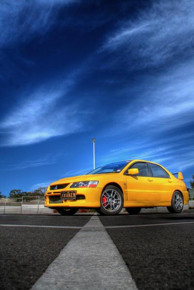 Yellow Mitsubishi Evo IX