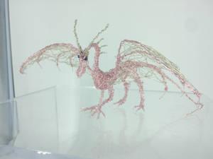 Pearlescent shoulder perching dragon
