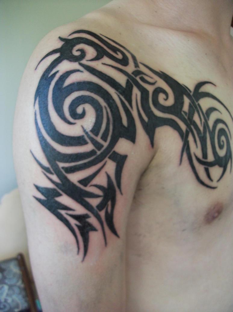 Tribal-Tattoos arm_and_chest_tribal_tattoo_by_blackspindl8-d68dojv