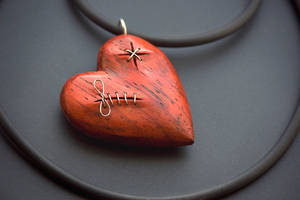 Stitched heart pendant by back2root