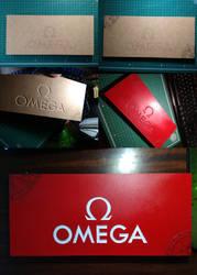 Omega logo wood carved