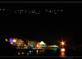 Marina del Cantone at night by Ravensilver