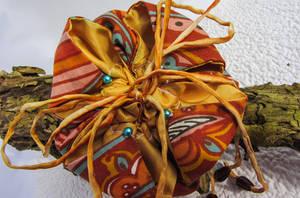 Orange flower pouch by Ravensilver
