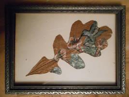 Hummingbird painted on an oak leaf