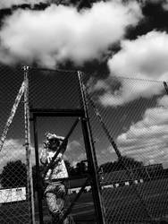 white clouds, fenced in