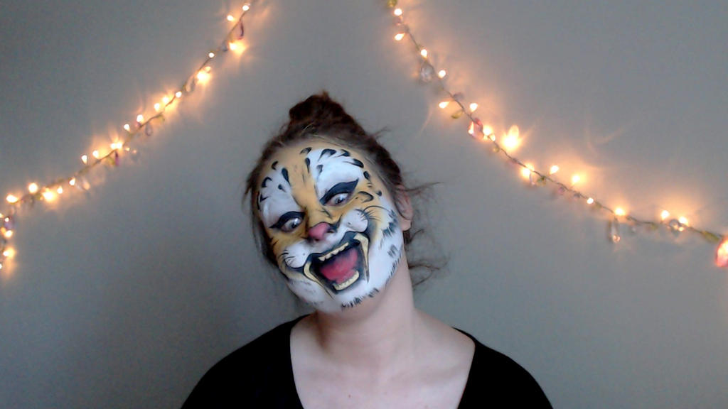 Hilarious saber tooth tiger facepaint by Blueberrystarbubbles