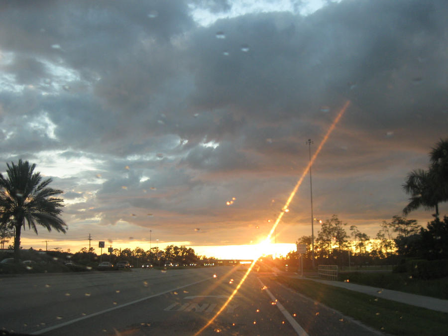 Rainy Window Sunset by KageCat34