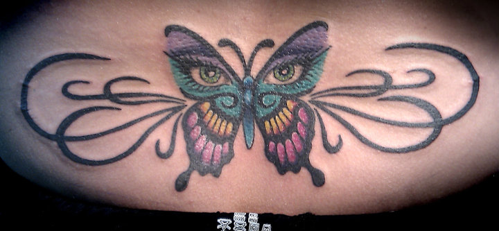 Butterfly tramp stamp tattoos