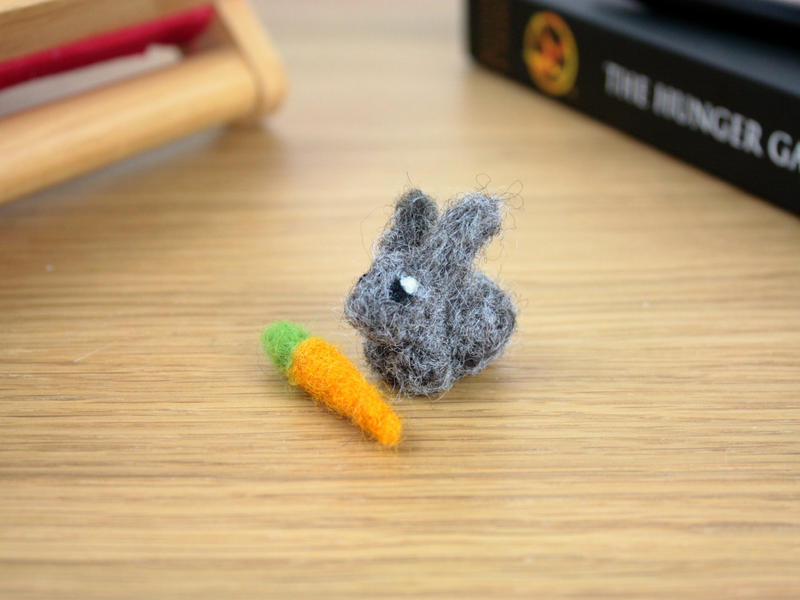 Needle felted tiny rabbit with carrot by eldris