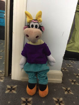 Clarabelle Wearing Blue Pants and Purple Shirt