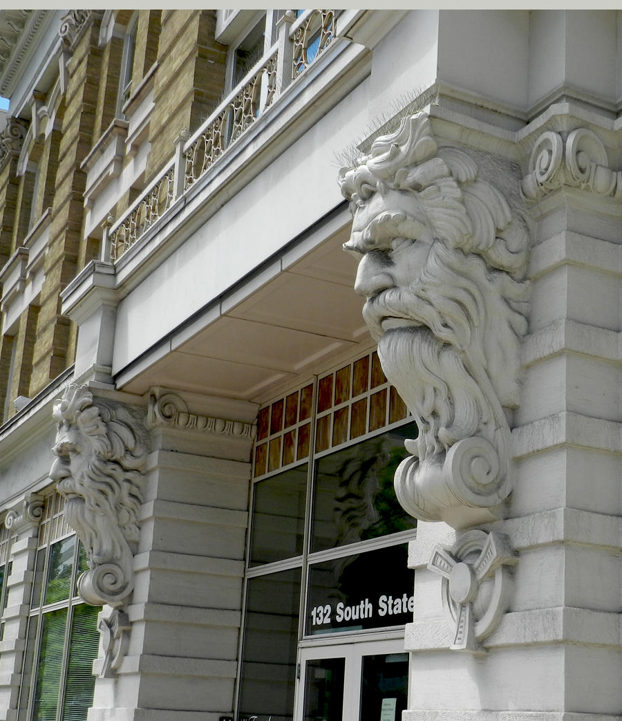 Carved stone men on building in slc sideview by eveyd