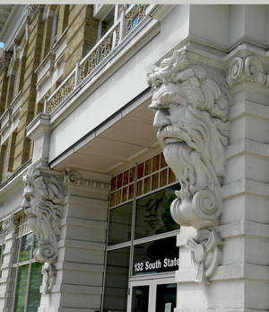 Carved Stone Men on Building in SLC - sideview