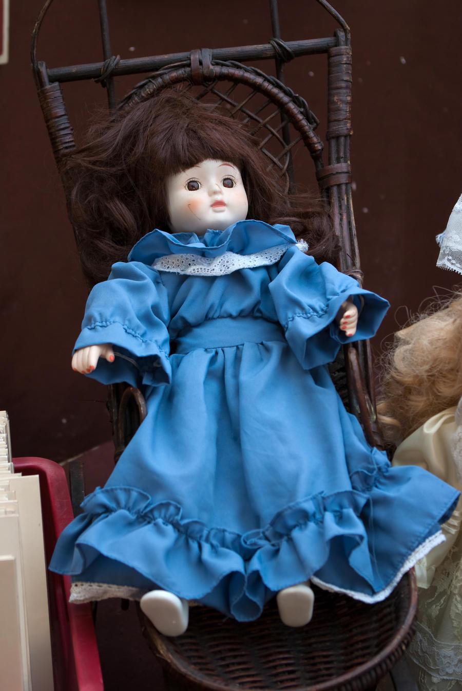Brunette porcelain doll by steppelandstock