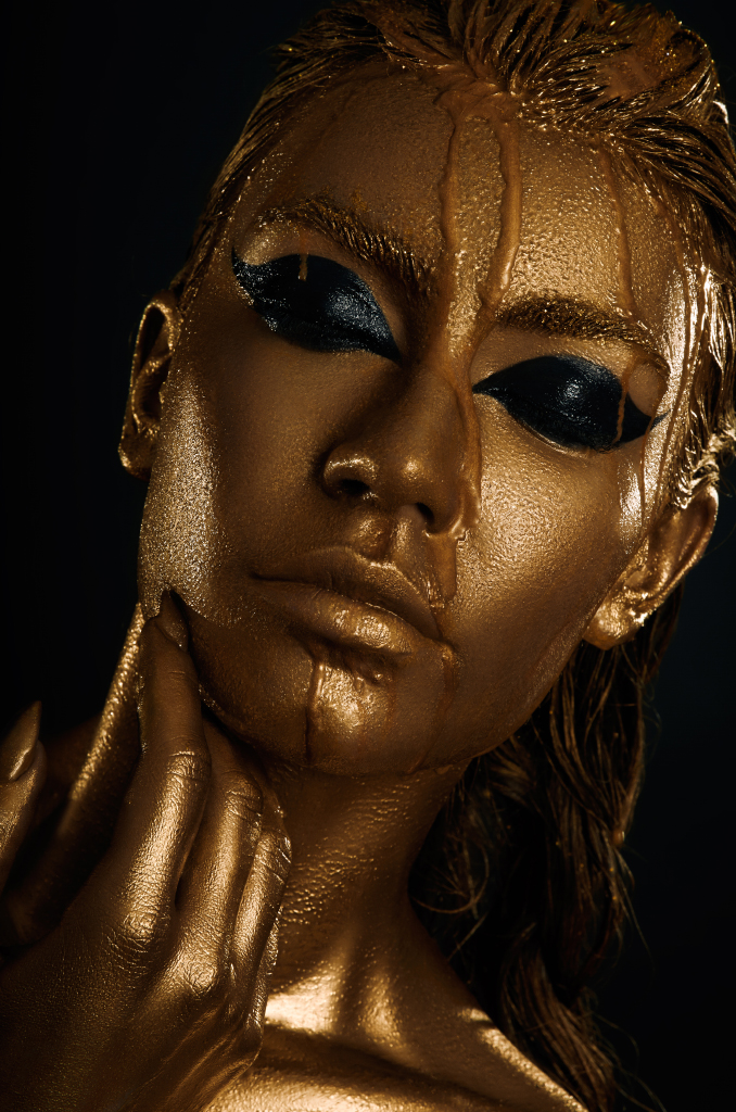 Black Women Painted Gold And Black