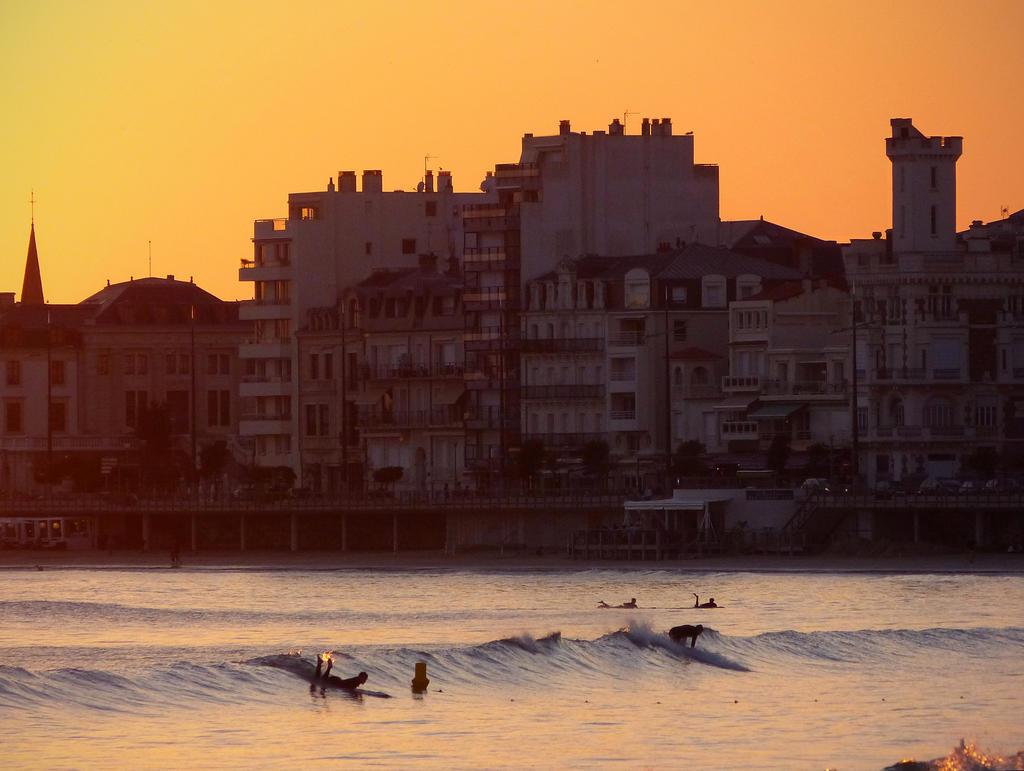 Surfing at sunset by bueyedgirl