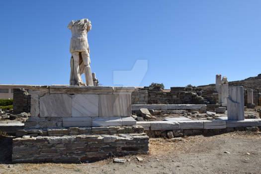 Stone headless statue of men in Delos island