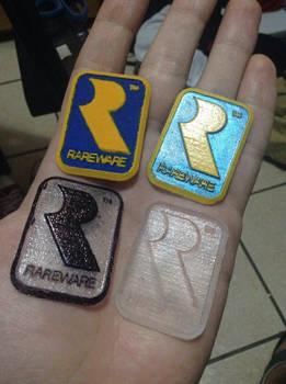 3D printed Rareware logo resin cast replicas.